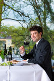 Businessman has lunch in restaurant Royalty Free Stock Photos