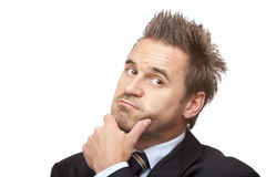 Businessman has problem and looks contemplative stock images
