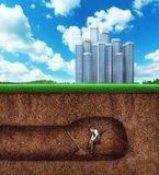 Businessman has a rest while digging tunnel Stock Photo