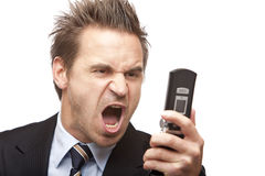 Businessman has stress with mobile phone Stock Images