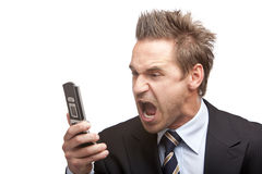 Businessman has stress on mobile phone Royalty Free Stock Photography