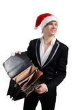 Businessman with a hat of Santa Claus. Young man with an empty briefcase and hat of Santa Claus on the white background Stock Photo