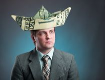Businessman with hat of ship from a money Royalty Free Stock Photography