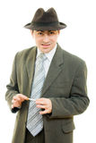 A businessman in a hat smokes Stock Photo