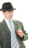 A businessman in a hat smokes Royalty Free Stock Photos