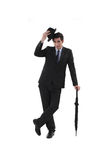 Businessman with a hat. And umbrella Stock Photography
