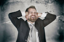 Businessman hate his work, screaming and covering his ears. Angry businessman stress work job furious business overload concept Stock Photography