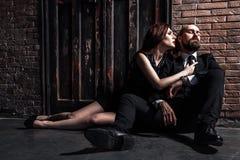 Businessman have a bad mood. Couple sitting on flor after quarre. L. Ginger women want kissing. Studio shot Stock Image