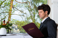Businessman have a lunch in restaurant Stock Image