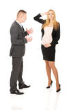 Businessman having argue with pregnant woman Stock Photography