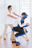 Businessman having back massage Royalty Free Stock Photo