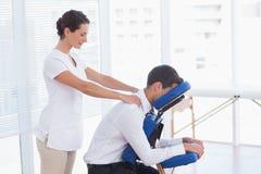 Businessman having back massage. In medical office royalty free stock image
