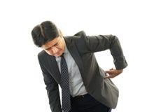Businessman having back pain Stock Image