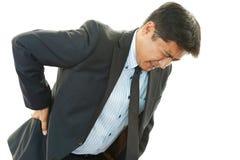 Businessman having back pain Royalty Free Stock Photos