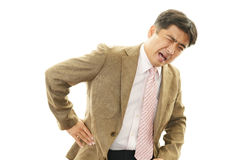 Businessman having back pain Royalty Free Stock Photography