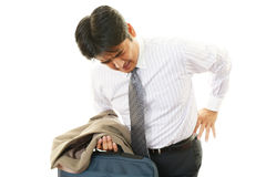 Businessman having back pain Stock Photography