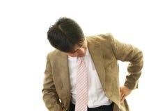 Businessman having back pain Stock Photos