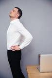 Businessman having backache Stock Image