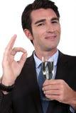 Businessman having champagne Stock Image
