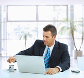 Businessman having coffee break Royalty Free Stock Image