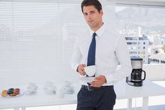 Businessman having a coffee during the break Royalty Free Stock Photos