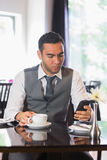 Businessman having coffee in restaurant Royalty Free Stock Images