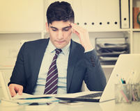 Businessman is having complicated issue in project. In office Stock Photo