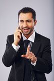 Businessman Having a Conversation on Phone Royalty Free Stock Image