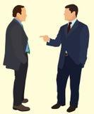 Businessman Having Conversation. Two Businessman Having a Conversation with  one Pointing at the Other Stock Photos