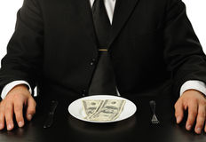 The businessman having dinner dollars Stock Photos