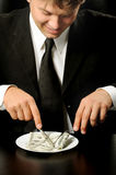 The businessman having dinner dollars Royalty Free Stock Photography