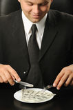 The businessman having dinner dollars Stock Images