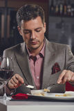 Businessman having dinner Stock Photography