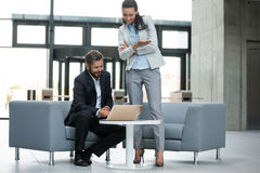Businessman having a discussion with colleague over laptop Stock Photos