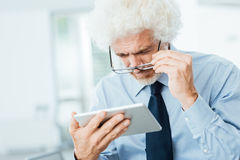 Businessman having eyesight problems Stock Photos