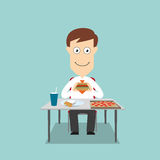 Businessman having fast food lunch Royalty Free Stock Photo