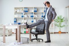 The businessman having fun taking a break in the office at work Stock Photo