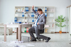 The businessman having fun taking a break in the office at work Royalty Free Stock Images