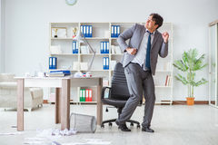 The businessman having fun taking a break in the office at work Royalty Free Stock Image