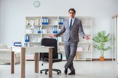 The businessman having fun taking a break in the office at work Stock Images