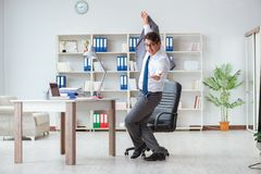 The businessman having fun taking a break in the office at work Stock Image