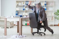 The businessman having fun taking a break in the office at work Stock Photography