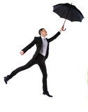Businessman having fun with umbrella Royalty Free Stock Images