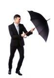 Businessman having fun with umbrella Stock Photo