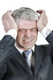 Businessman under pressure. Businessman having head ache. Caused by business pressure Royalty Free Stock Photo