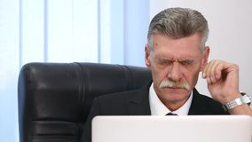 Businessman having head pain during work in office.  stock video footage
