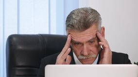 Businessman having head pain during work in office.  stock footage