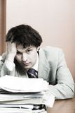 Businessman having headache Stock Photo