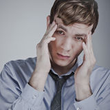 Businessman having a headache Royalty Free Stock Photography