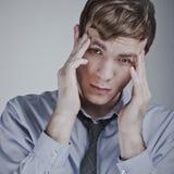 Businessman having a headache Royalty Free Stock Photography